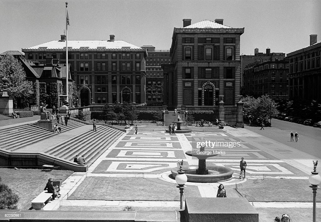 Urban scene with fountain on square : Stock Photo