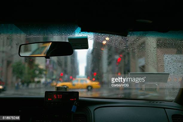 Urban setting seen through a taxi window