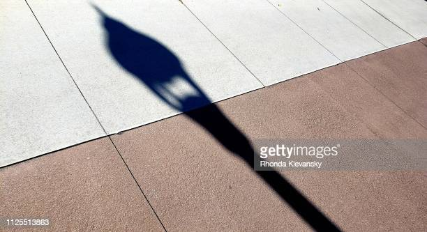 urban sidewalk shadow - rhonda klevansky ストックフォトと画像