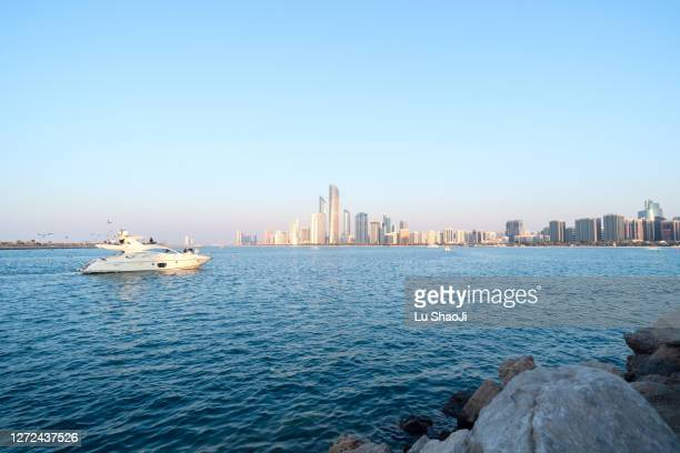 urban skyline and cityscape at sunset in abu dhabi.uae - seascape stock pictures, royalty-free photos & images