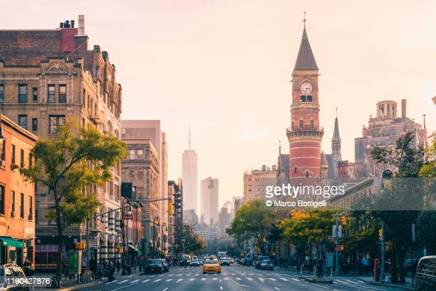 urban skyline at sunset, new york city - new york city stock pictures, royalty-free photos & images