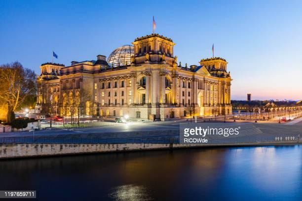 urban skyline of berlin, germany - reichstag stock-fotos und bilder