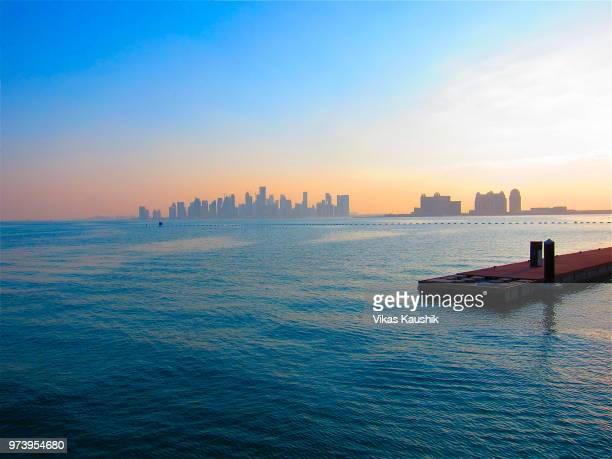 Urban skyline of Doha Corniche seen from water, Doha, Qatar