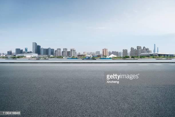 urban skyline, parking lot - day ストックフォトと画像