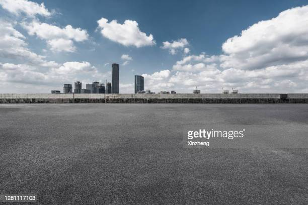 urban skyline, parking lot - tarmac stock pictures, royalty-free photos & images
