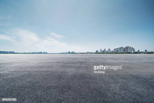urban skyline, parking lot - asphalt stock pictures, royalty-free photos & images