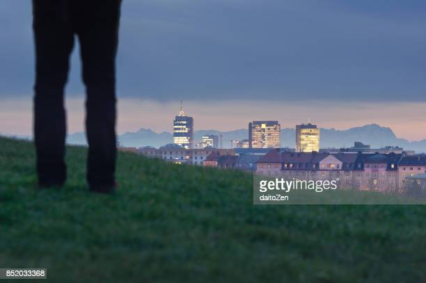 Urban skyline with modern office buildings and Zugspitze mountain in the background, Munich, Bavaria, Germany, Europe