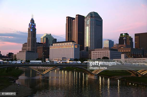 urban skyscrappers along scioto river, columbus, ohio, usa - columbus ohio stock photos and pictures