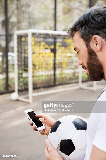 Urban Soccer Guy With Smart Phone