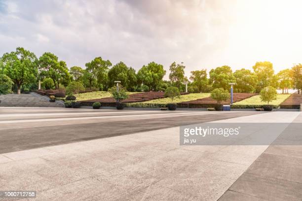 urban square with garden against sky - paving stone stock pictures, royalty-free photos & images