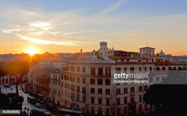 urban street and skyline at sunset in Rome