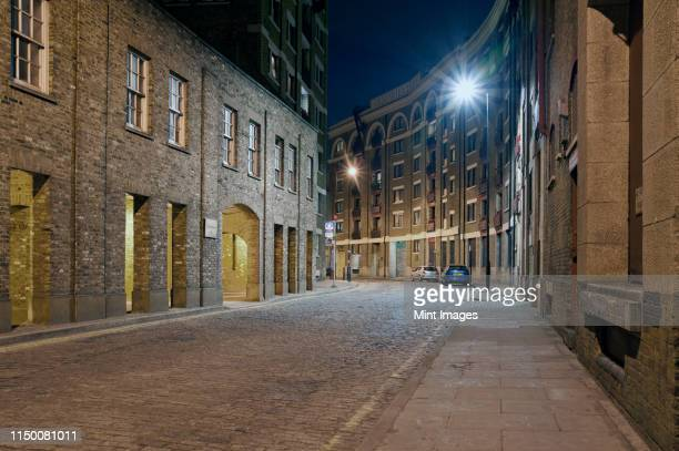 urban street in the docklands of london - east london stock pictures, royalty-free photos & images