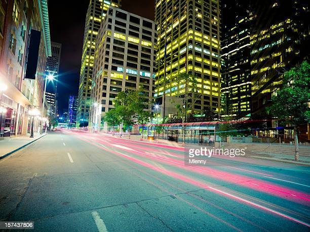 urban street scene at night - calgary alberta stock pictures, royalty-free photos & images