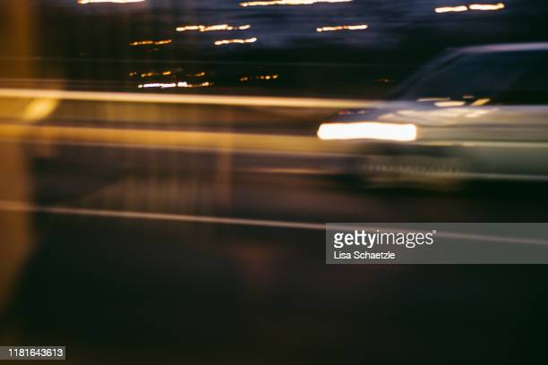 urban street scene – car driving by - lisa strain stock pictures, royalty-free photos & images