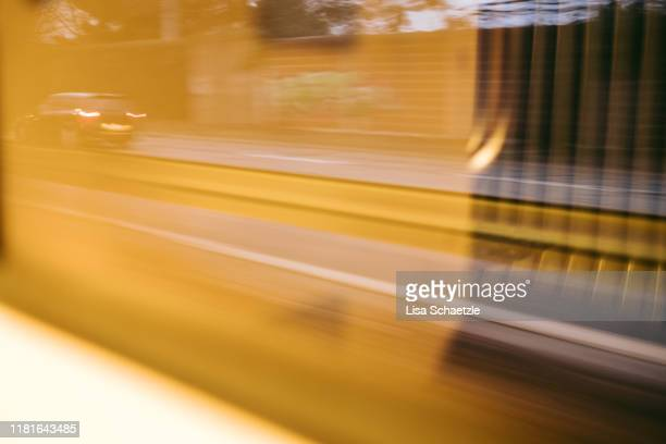 urban street scene – light reflection in the train - lisa strain stock pictures, royalty-free photos & images
