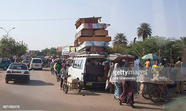 Urban traffic in Niamey furniture is stacked on the roof of a mini van on December 08 in Niamey Niger Photo by Ute Grabowsky/Photothek via Getty...