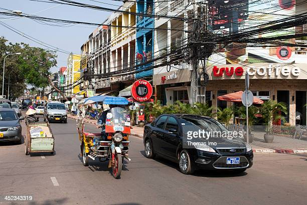 Urban traffic in the streets of Vientiane tuktuk cars and pedestrians on a street on February 17 in Vientiane Laos