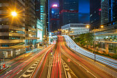 urban traffic with cityscape at night in Hong Kong