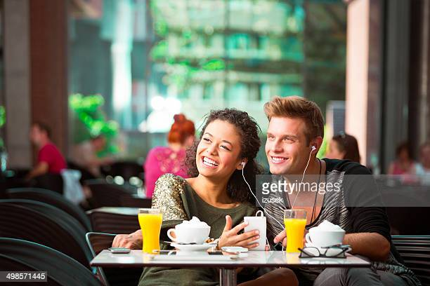 urban young people in cafe - mp3 juices stock photos and pictures