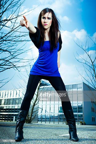 Urban Young Woman Pointing