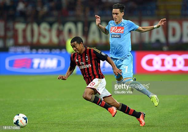 Urby Emanuelson of AC Milan and Jose Maria Callejon of SSC Napoli compete for the ball during the Serie A match between AC Milan and SSC Napoli at...
