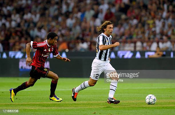Urby Emanuelson of AC Milan competes for the ball with Andrea Pirlo of Juventus FC during the Berlusconi Trophy match between AC Milan and Juventus...