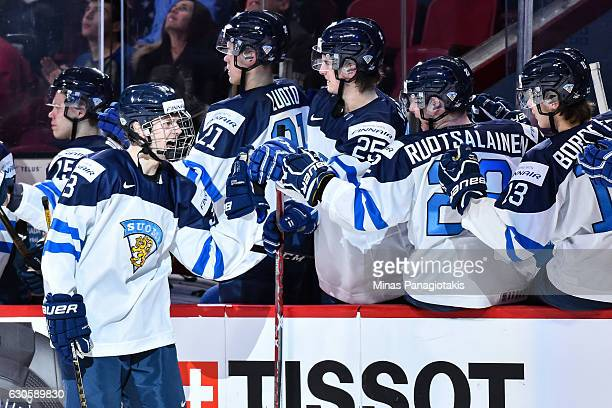 Urho Vaakanainen of Team Finland celebrates his goal with teammates on the bench during the IIHF World Junior Championship preliminary round game...