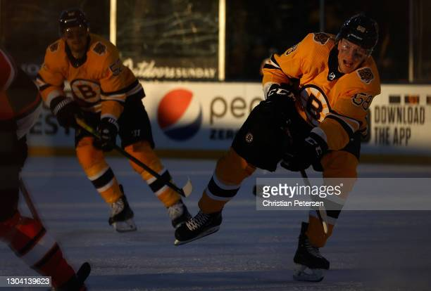 Urho Vaakanainen of the Boston Bruins dumps the puck into the zone during the first period of the 'NHL Outdoors At Lake Tahoe' against the...