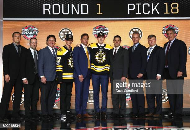 Urho Vaakanainen poses onstage with team personnel after being selected 18th overall by the Boston Bruins during Round One of the 2017 NHL Draft at...