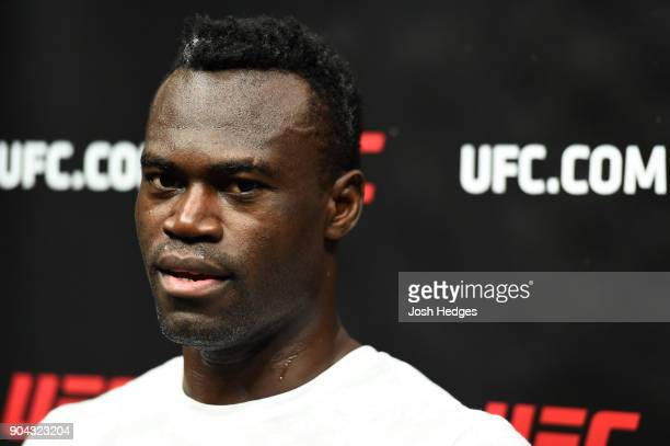 Uriah Hall of Jamaica interacts with media after a workout at the Scottrade Center on January 12 2018 in St Louis Missouri