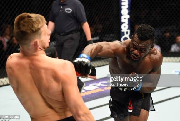 Uriah Hall of Jamaica punches Krzysztof Jotko of Poland in their middleweight bout during the UFC Fight Night event inside the PPG Paints Arena on...