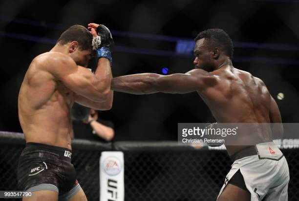 Uriah Hall of Jamaica punches Paulo Costa of Brazil in their middleweight fight during the UFC 226 event inside TMobile Arena on July 7 2018 in Las...