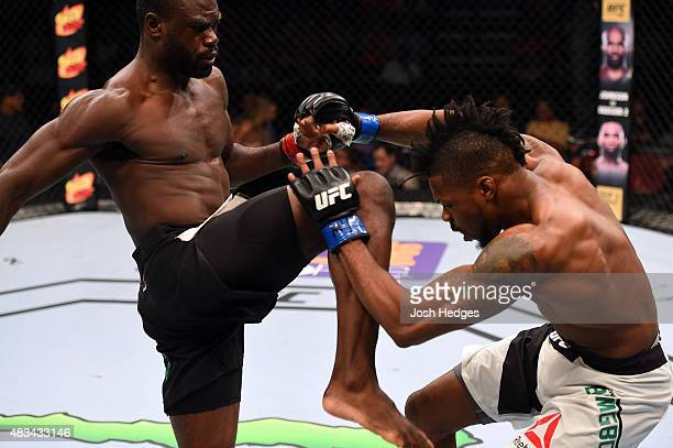 Uriah Hall of Jamaica throws a knee at Oluwale Bamgbose in their middleweight bout during the UFC Fight Night event at Bridgestone Arena on August 8...