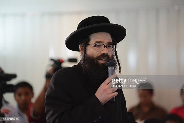 Urias Goldman member of the Orthodox Jewish community speak during a meeting with leaders of San Juan La Laguna community at the headquarters of the...