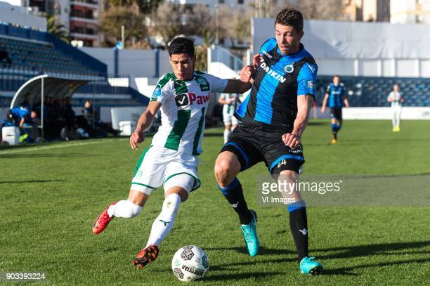 Uriel Antuna of FC Groningen Brandon Mechele of Club Brugge during the friendly match between FC Groningen and Club Brugge at Estadio Municipal on...
