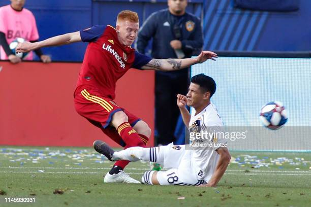Uriel Antuna of Los Angeles Galaxy slides into Justen Glad of Real Salt Lake during a game at Dignity Health Sports Park on April 28 2019 in Carson...