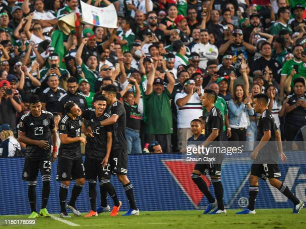 Uriel Antuna of Mexico celebrates his second goal with Jesus Gallardo of Mexico during the 2019 CONCACAF Gold Cup Group A match between Mexico and...