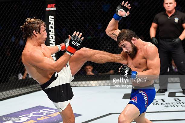Urijah Faber kicks Jimmie Rivera in their bantamweight bout during the UFC 203 event at Quicken Loans Arena on September 10 2016 in Cleveland Ohio