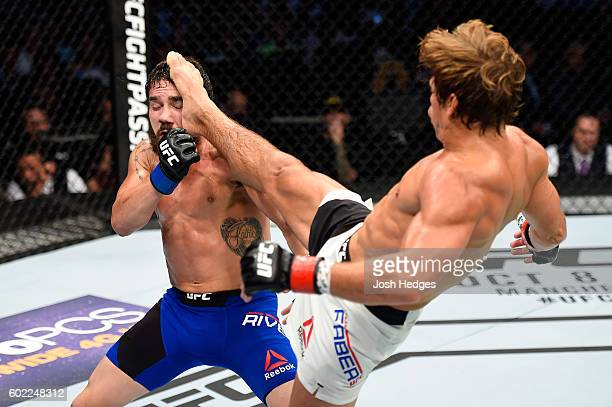 Urijah Faber lands a kick to the face of Jimmie Rivera in their bantamweight bout during the UFC 203 event at Quicken Loans Arena on September 10...