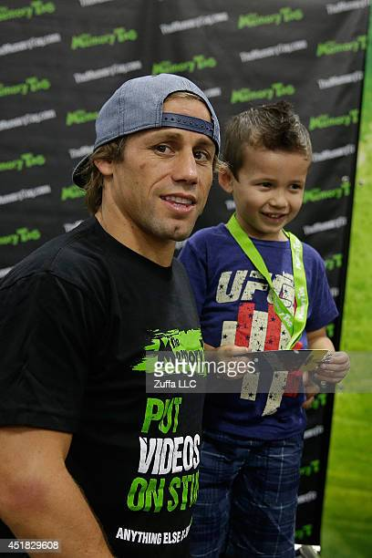 Urijah Faber poses with a fan during the UFC Fan Expo 2014 during UFC International Fight Week at the Mandalay Bay Convention Center on July 6 2014...