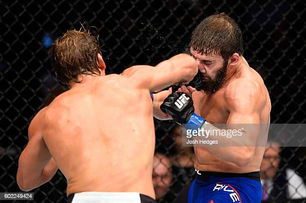 Urijah Faber punches Jimmie Rivera in their bantamweight bout during the UFC 203 event at Quicken Loans Arena on September 10 2016 in Cleveland Ohio