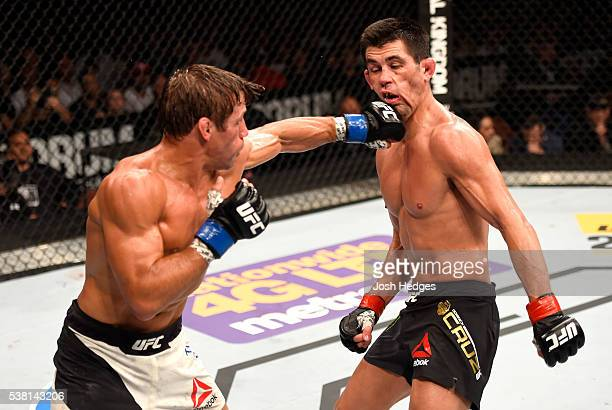 Urijah Faber throws a left punch at Dominick Cruz in their UFC bantamweight championship bout during the UFC 199 event at The Forum on June 4 2016 in...