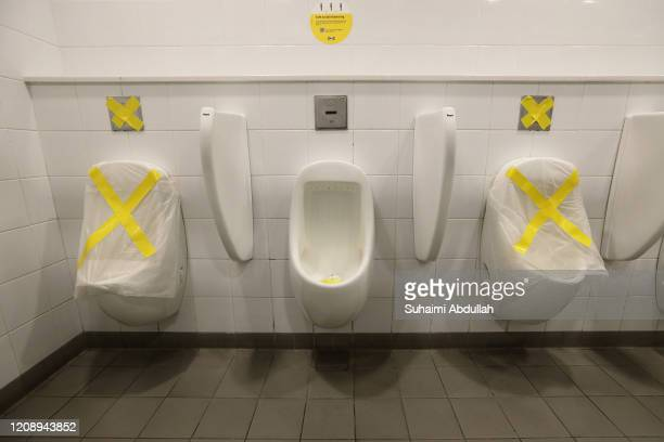 Urinals at Ikea outlet are marked out to encourage shoppers to practise safe distancing as authorities implement a social distancing measures to...