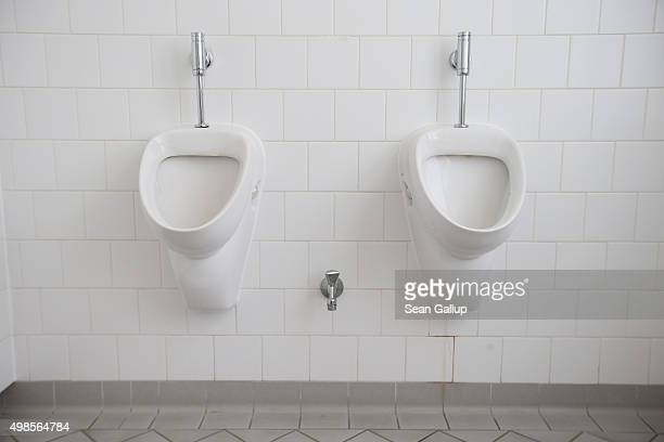 Urinals hang on a wall in a newlyinaugurated genderfree toilet at the office building of the city's Senate Administration for Work Integration and...
