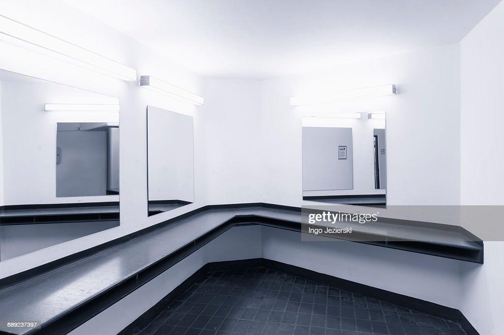 Urinals in public men's washroom : Stock Photo