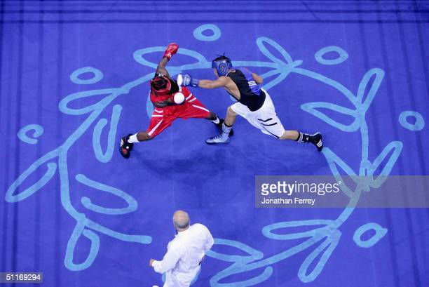 Urkirbek Haydarov of Uzbekistan lands a punch aginst Isaac Ekpo of Nigeria during the men's boxing 81 kg preliminary bout on August 14 2004 during...