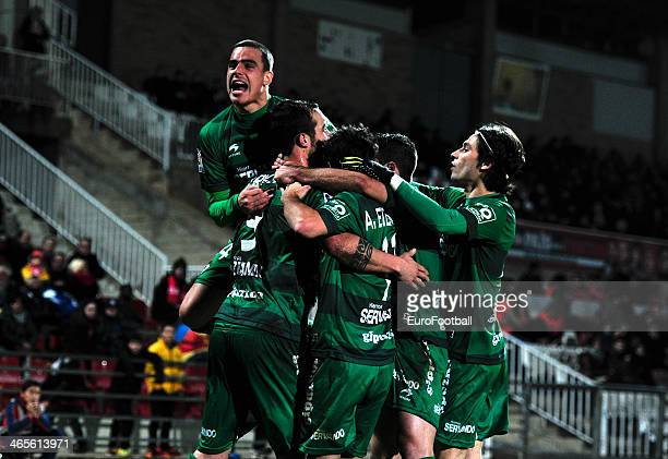 Urko Vera of SD Eibar is congratulated by his teammates during the Spanish Segunda Division match between Girona FC and SD Eibar at the Estadia...