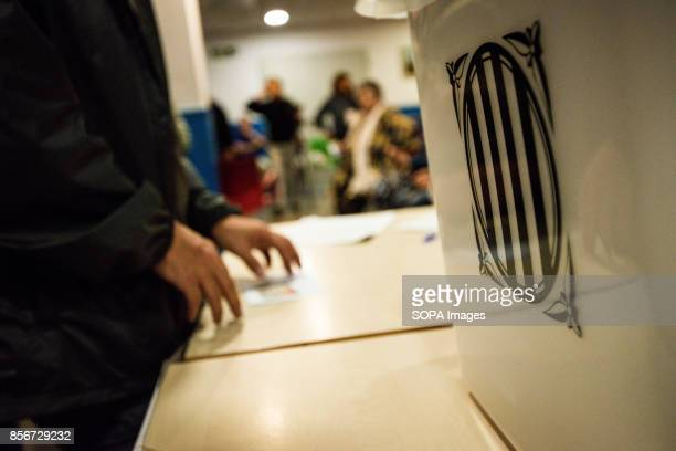 Urn at a polling station More than five million eligible Catalan voters are estimated to visit 2315 polling stations today for Catalonia's referendum...