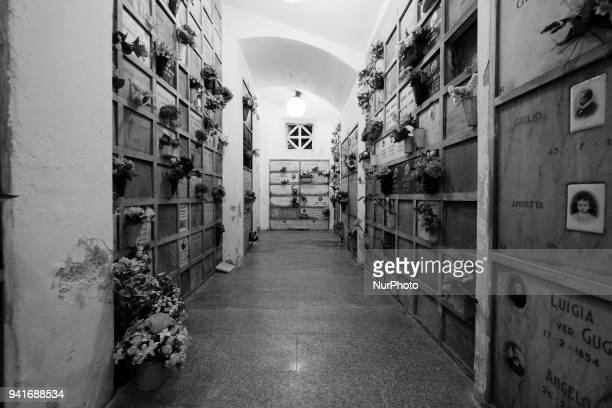 Image has been converted to black and white Urn graves at Monumental Cemetery of Milan stands out for the large number of tombs of high artistic...