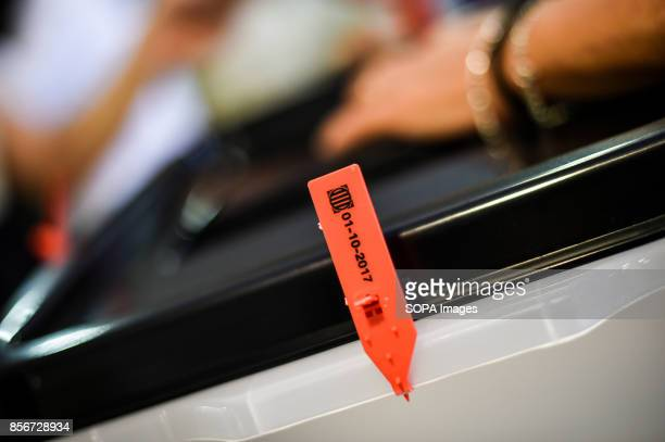 Urn with the date of referendum More than five million eligible Catalan voters are estimated to visit 2315 polling stations today for Catalonia's...